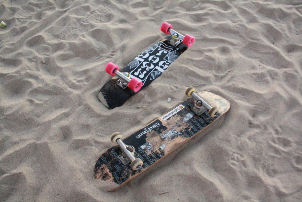 Skateboards in the sand
